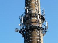 zdjęcie stacji bazowej Piastowska 19 komin (Era GSM900/GSM1800, Orange GSM900/GSM1800, Play UMTS) p1030835.jpg